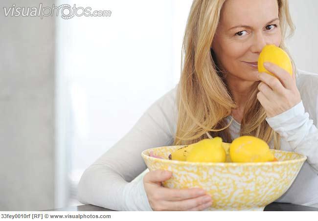 Woman smelling lemons