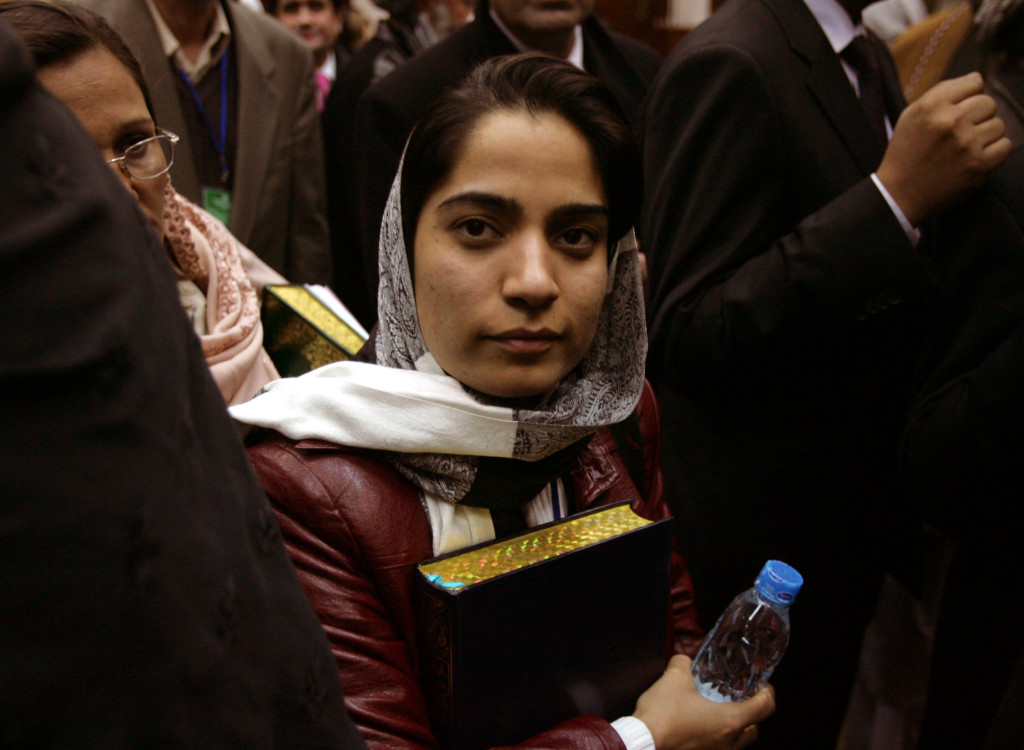 Member of the parliament Malalai Joya holds a copy of the holy Koran in Kabul