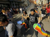LGBT rights activists run as riot police use a water cannon to disperse them before a Gay Pride Parade in central Istanbul, Turkey, June 28, 2015. Turkish police fired water cannon and rubber pellets to disperse a crowd gathered in central Istanbul for the city's annual gay pride parade, a Reuters cameraman at the scene said. The police appeared intent on stopping the crowd gathering near Taksim Square, the cameraman said. Taksim is a traditional rallying ground for demonstrators and saw weeks of unrest in 2013. REUTERS/Huseyin Aldemir