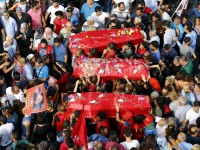 Relatives and friends carry coffins of the victims of Monday's bomb attack in Suruc, during a funeral ceremony in Istanbul, Turkey, July 22, 2015. A suspected Islamic State suicide bomber killed at least 30 people, mostly young students, in an attack on the Turkish town of Suruc near the Syrian border on Monday. REUTERS/Murad Sezer