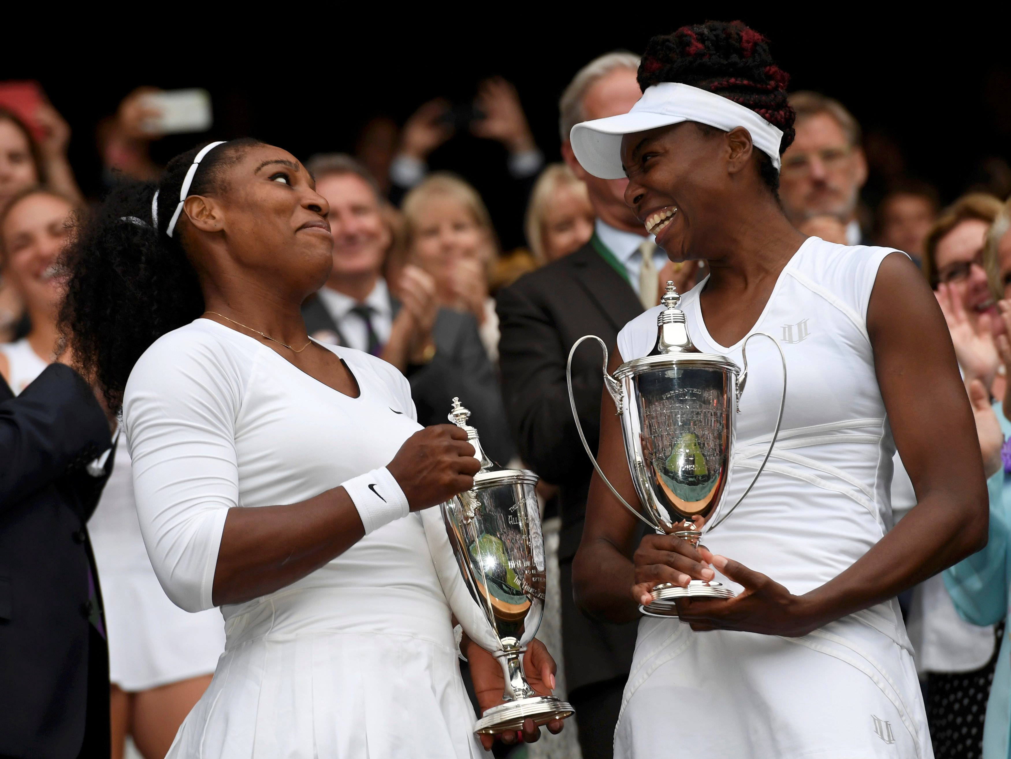 Britain Tennis - Wimbledon - All England Lawn Tennis & Croquet Club, Wimbledon, England - 9/7/16 USA's Serena Williams and Venus Williams celebrate winning their womens doubles final against Hungary's Timea Babos and Kazakhstan's Yaroslava Shvedova with the trophies REUTERS/Tony O'Brien