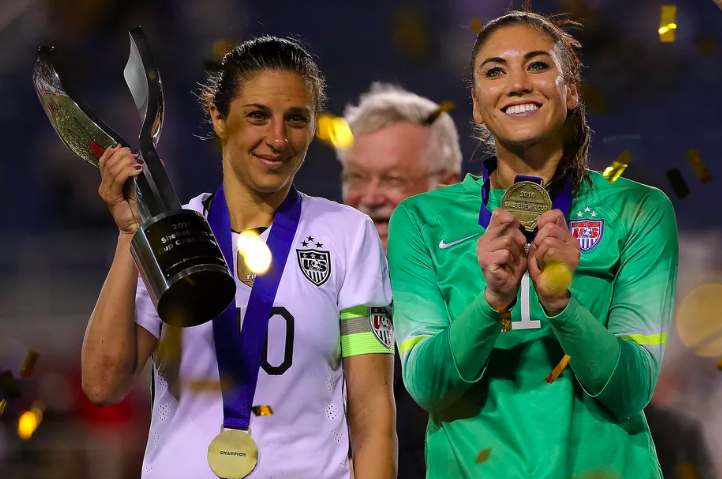 Carli Lloyd ve Hope Solo