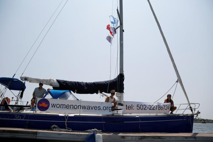 Members of Women on Waves, a Dutch non-profit that provides abortion services beyond the territorial waters of countries where abortion is illegal, are seen on their ship at a pier in Puerto de San Jose, Guatemala February 23, 2017. REUTERS/Luis Echeverria